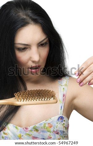 Brunette woman with long hair  collecting hairs on the brush hair and being very shocked and scared to lose her hair isolated on white background
