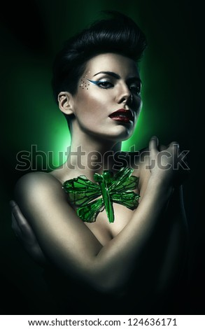 brunette woman with red lips and green dragon-fly - stock photo