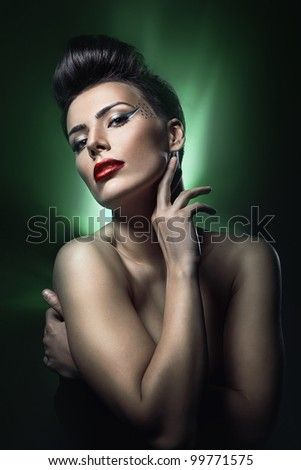 brunette woman with red lips in green light - stock photo