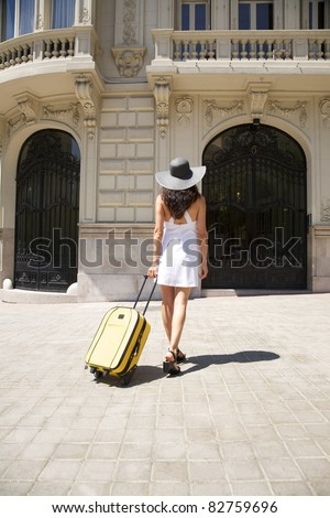 brunette woman with white dress walking in Madrid city Spain - stock photo