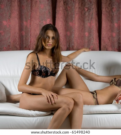 brunette women portrait closeup, lying at legs of other girl