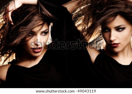 brunette women portrait with hair in motion, studio shot - stock photo