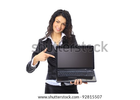 Brunette young businesswoman showing a laptop screen with copys pace - stock photo