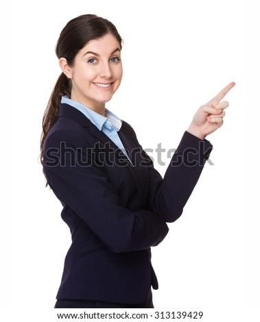 Brunette young businesswoman with finger point up