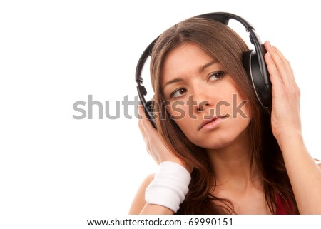 Brunette young woman listening music  big headphones and thinking  isolated on white background - stock photo