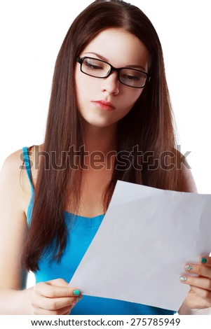 brunette young woman shocked realizes that something amazing or bad happened reading a white letter or document - stock photo