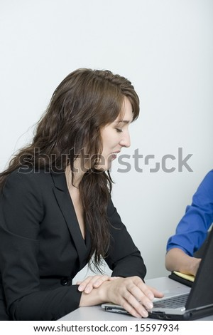 brunettes in office situation doing various tasks