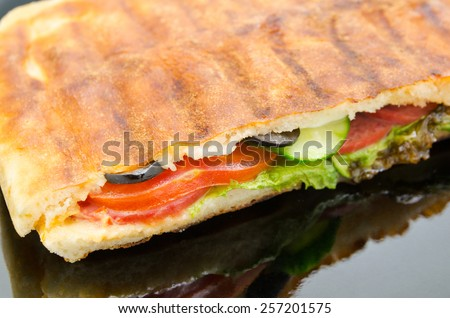 bruschetta, grilled sandwich with ham and lettuce - stock photo