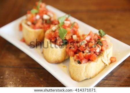 Bruschetta Italian Toasted Garlic Bread with tomato - stock photo