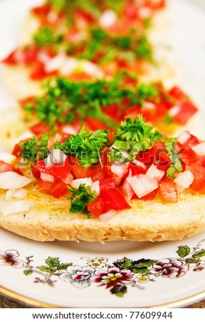 Bruschetta ( Italian Toasted Garlic Bread ) with tomato, onions and freshly chopped parsley, shallow dof - stock photo