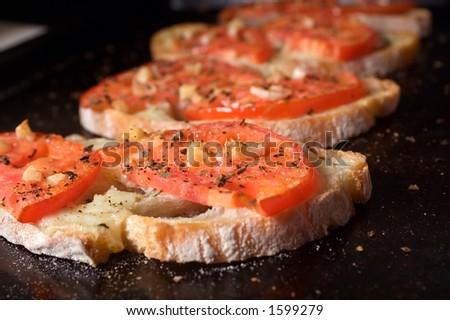 Bruschetta on dark tray. - stock photo