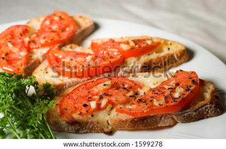 Bruschetta on white plate. - stock photo