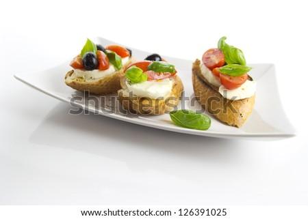 bruschetta over white background - stock photo