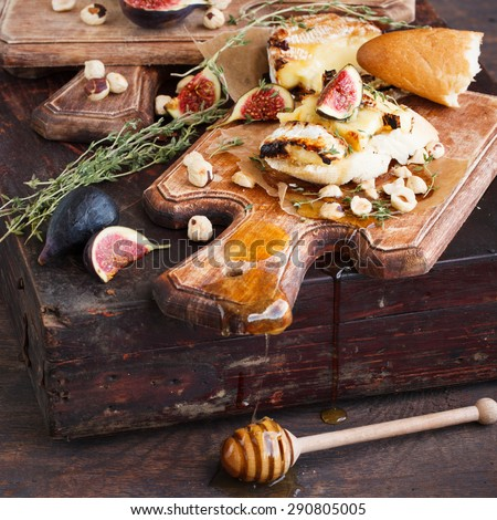 Bruschetta with cheese, figs , thyme and walnuts.selective focus - stock photo