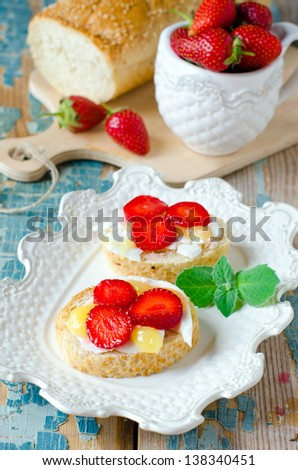 Bruschetta with cheese , honey and strawberries. Selective focus