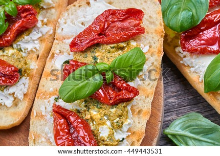 Bruschetta with dried tomatoes, feta cheese and home made pesto