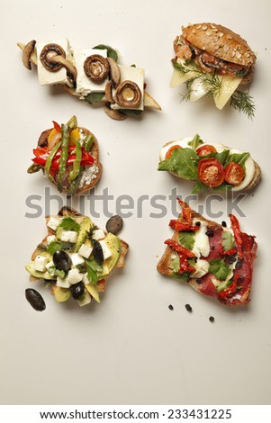 Bruschetta with grilled bell pepper, zucchini, mozzarella cheese and herbs. Vegetarian dish - stock photo