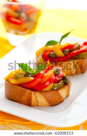 Bruschetta with roasted bell pepper,capers and basil