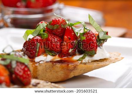 bruschetta with strawberries - stock photo