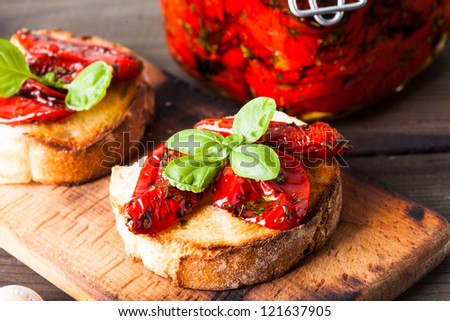 Bruschetta with sun dried tomatoes, basil leaves and garlic