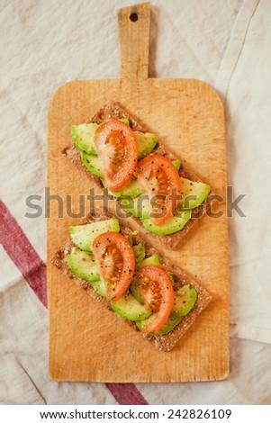bruschetta with tomato and avocado - stock photo
