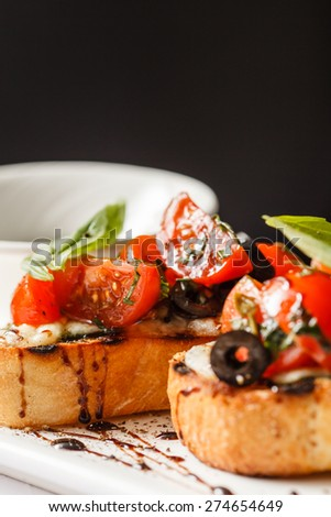 Bruschetta with tomato, mozarella and basil - stock photo