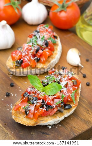 bruschetta with tomato, olives, basil and cheese