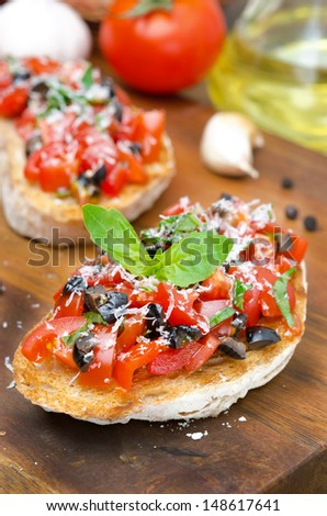 bruschetta with tomato, olives, basil and cheese closeup, selective focus