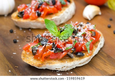 bruschetta with tomato, olives, basil and cheese horizontal close-up - stock photo