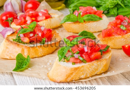 Bruschetta with tomato, onion and fresh basil
