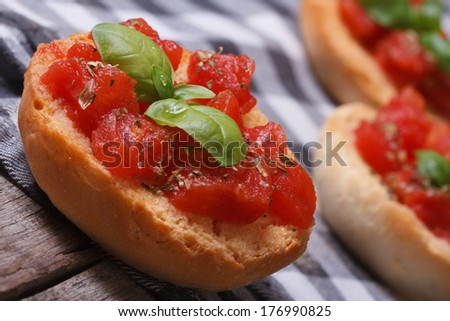 Bruschetta with tomatoes and basil close-up on wooden table  - stock photo