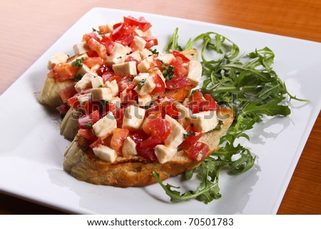 Bruschetta with tomatoes and cheese - stock photo