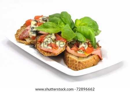 bruschetta with tomatoes and gorgonzola cheese served with fresh basil ...