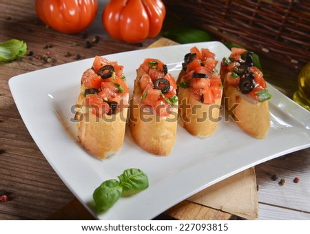 bruschetta with tomatoes, olives and basil - stock photo
