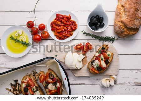 Bruschetta with tomatoes, pepper, mozzarella and garlic - stock photo