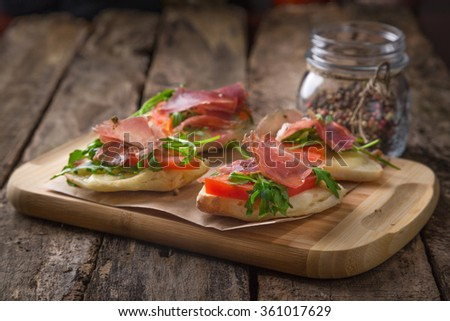 Bruschetti on wooden table - stock photo