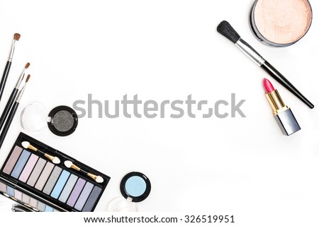 Brush and cosmetic isolated on a white background. Top view. - stock photo