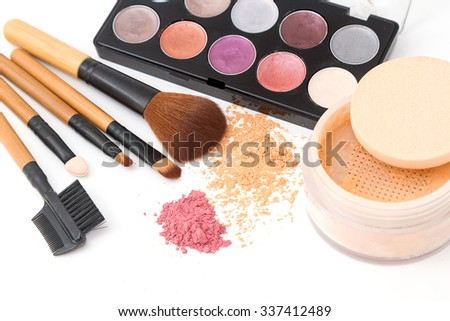 Brush and cosmetic set  isolated on a white background