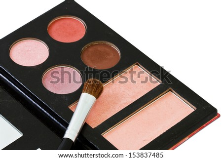 brush and cosmetics, on a white background isolated
