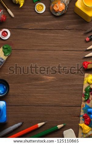 brush and painting  on wood background - stock photo