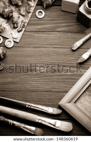 brush and painting  on wood background - stock photo