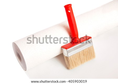 Brush and roll of wallpaper isolated on white background - stock photo