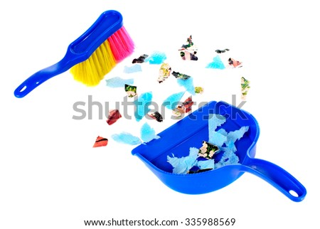 Brush and scoope with garbage isolated on white background - stock photo