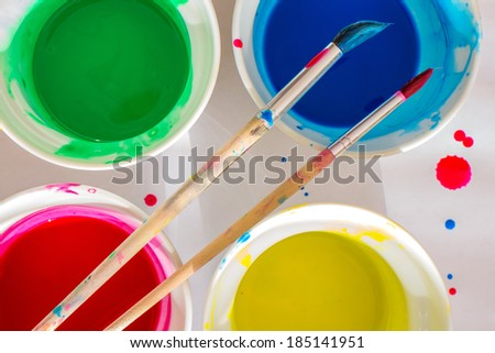 Brush and water-color paint buckets - stock photo