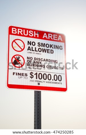 Brush area sign warning people not to smoke due to the fire danger