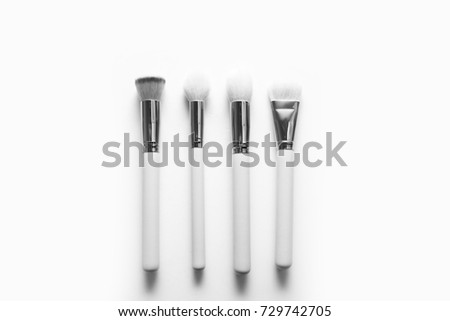 Brush background / A makeup brush is a tool with bristles used for the application of makeup or face painting. The bristles may be made out of natural or synthetic materials
