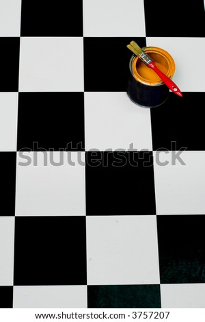 brush for painting and paint bucket on black and white floor - stock photo