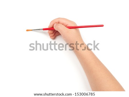 brush for painting in child hand - stock photo