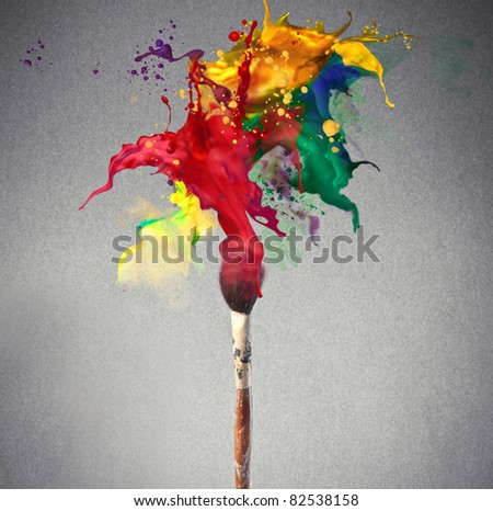 Brush full of colored paint - stock photo