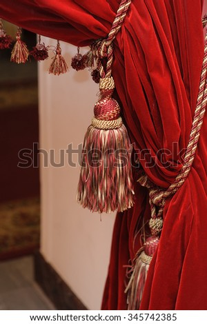 brush on a red theater curtain. - stock photo